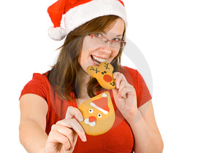 Santa Girl With Red Specs And Gingerbread Stock Image - Image: 3821761
