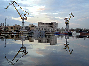 Shipyard View Reflected In Water Stock Photography - Image: 3860822