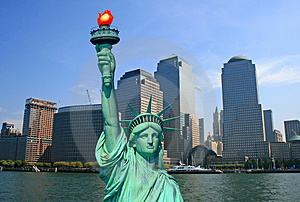 The Statue of Liberty and NYC skyline Royalty Free Stock Photo