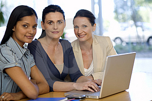 Three businesswoman with laptop Free Stock Photo