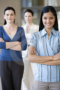 Businesswoman with team behind Royalty Free Stock Photography