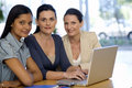 Three businesswoman with laptop Royalty Free Stock Photo