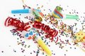 Red and golden ribbons and small confetti colorful Stock Photos