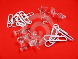 Paper Clips And Push Pins Over Red Background Royalty Free Stock Images - Image: 399349