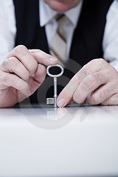 Businessman with key Royalty Free Stock Photo