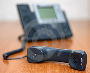 Telephone receiver with phone on background Royalty Free Stock Image