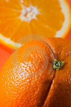 One orange, one half orange Royalty Free Stock Image