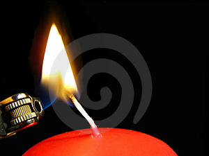 Red Candle with Lighter Royalty Free Stock Images