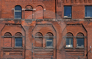 Exterior Of Brick Building With Windows Free Stock Photo