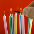 Lighting birthday candles Royalty Free Stock Images