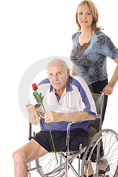 Beautiful daughter pushing her elderly father Stock Photography