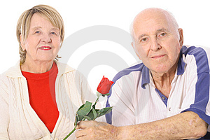 Happy seniors with Valentines rose Stock Photos