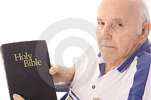Grandfather with a bible Royalty Free Stock Image