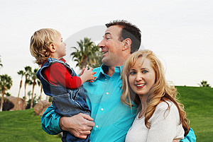 Happy couple with a child Stock Photography