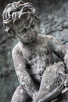 Statue Of Boy Looking At Seashell Stock Photo - Image: 4028730