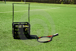 Tennis Racket And Tennis Balls On A Court Stock Image - Image: 4029001