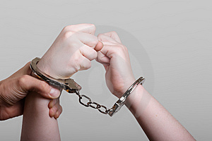 Handcuff struggle Stock Photo