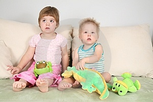 Two children with toys Stock Photo