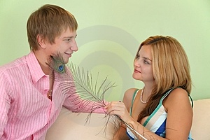 Girl Caress Fellow On Face By  Feather Royalty Free Stock Photo - Image: 4039675