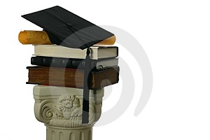 Mortar board and diploma on stack of books