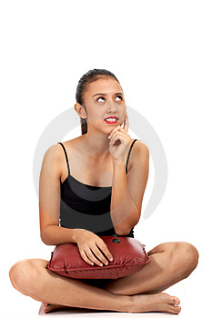 Girl sitting down and thinking Royalty Free Stock Images