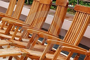 Wooden Chair At The Pool Side Royalty Free Stock Photos - Image: 4101978