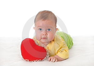 Baby With A Soft Toy In The Form Of Heart Stock Image - Image: 4103881