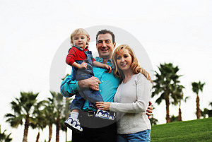 Happy couple with a child Royalty Free Stock Photography