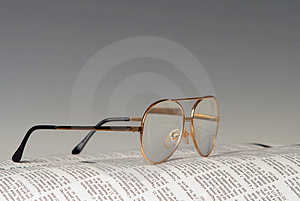 Newspaper and glasses Free Stock Image