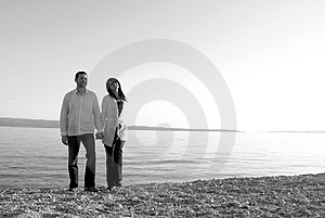A Young Couple Walking Along A Royalty Free Stock Image - Image: 4175876