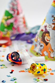 Party blowers with party hats and confetti Royalty Free Stock Photos