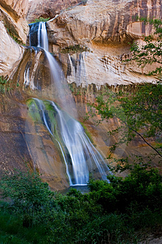 Waterfall Against Red Rock Stock Photography - Image: 4197062