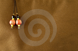 Bead Over Textile Background Royalty Free Stock Image - Image: 4210476