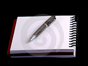 Pen on notebook Royalty Free Stock Image