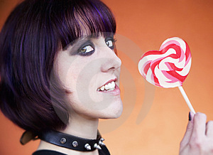 Alternative Girl With A Heart Lollipop Stock Photo - Image: 4215760