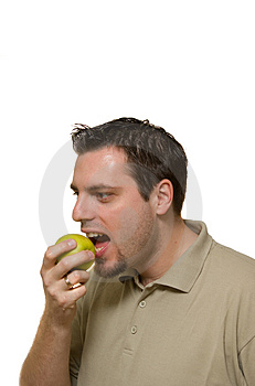 Young Man Eating A Green Apple Stock Photos - Image: 4223103
