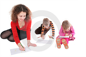 Mother with children drawing Stock Photos