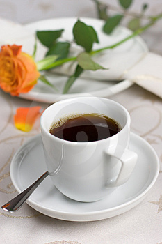 Cup of coffee with orange rose Royalty Free Stock Photos