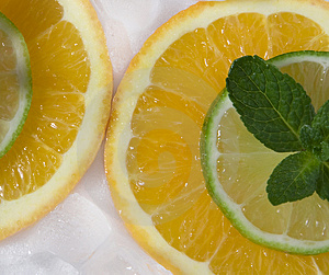 Lime And Orange Segments Whith Mint Royalty Free Stock Image - Image: 4312006