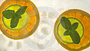 Lime And Orange Segments Whith Mint Stock Images - Image: 4312024