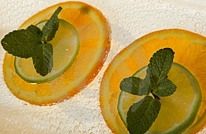 Lime And Orange Segments Whith Mint Royalty Free Stock Image - Image: 4312026