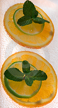 Lime And Orange Segments Whith Mint Royalty Free Stock Images - Image: 4312079