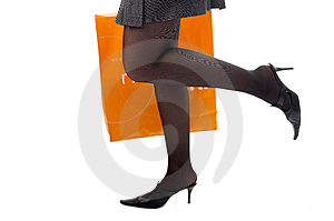Woman Legs With Packet Run Shopping Royalty Free Stock Photo - Image: 4341625