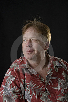 Unshaven middle aged man in floral shirt man Royalty Free Stock Photos
