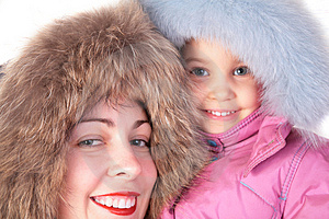 Mother With Child In Furry Hats Stock Photography - Image: 4387942