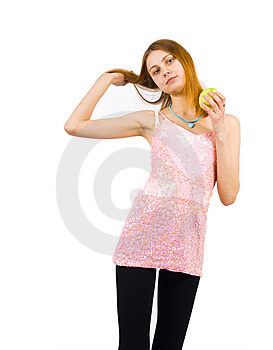 A Slim Girl In Pink Dress With Green Apple Stock Photography - Image: 4435712