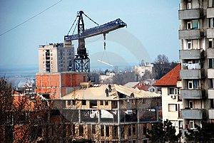 Workers On A Roof - Lifting Crane Royalty Free Stock Photos - Image: 4449188