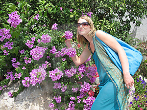 Girl Smelling Flowers Stock Photos - Image: 4482673