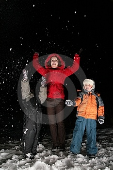 Children And Mother Throw Snow In Night 3 Stock Photos - Image: 4485613