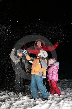 Children And Mother Throw Snow In Night Stock Image - Image: 4485651